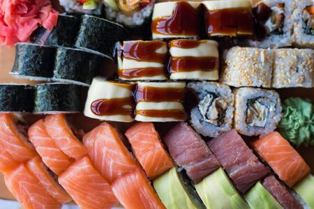 Assorted sushi. Typical japanese food. Variety of maki and rolls. Top view close up. 스톡 콘텐츠