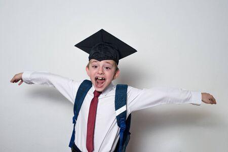Happy cheerful schoolboy in graduate hat. Passed the exams. Junior High School.