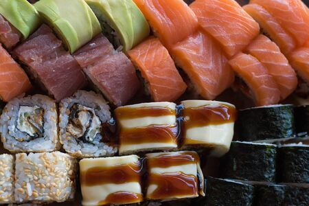 Maki ands rolls with tuna, salmon and avocado. Typical japanese food. Sushi Set.