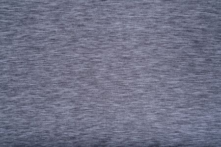 Gray abstract background. Monochromatic grey fabric backdrop copy space.