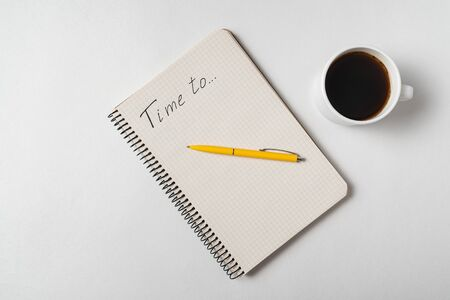 Time To reminder Notice. Notepad, pen and cup of coffee on white background