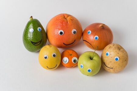products with funny faces, Googly eyes and smiles. international friendship concept. Standard-Bild