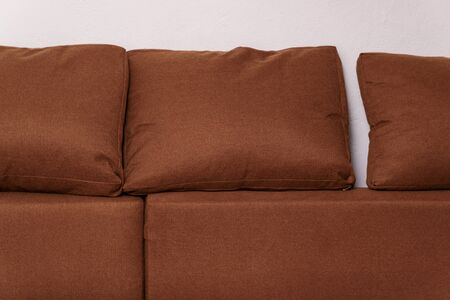 upholstery sofa and cushions brown textile. Furniture home.