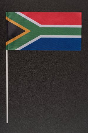 RSA flag on black background. National symbols of Republic of South Africa. Vertical frame.