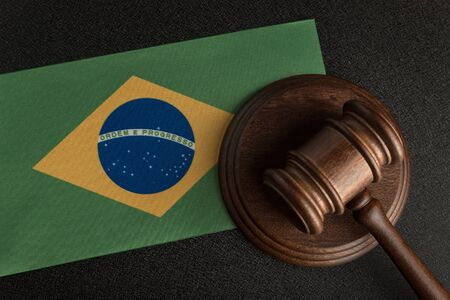 Judge or auction gavel on background of flag of Brazil. Constitutional human rights. Legality concept. Stock Photo