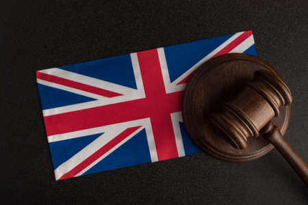 Judge Gavel and flag of United Kingdom. Law and justice in UK