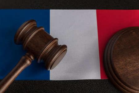 Justice mallet on France flag close up. Constitutional law. French legislation. Imagens