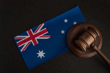 Judge gavel near the Australian flag. Court in Australia. Australian auction. Imagens