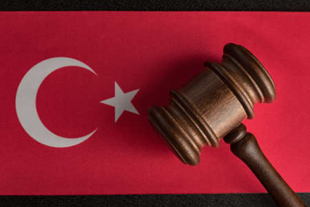 Judges hammer on the flag of Turkey. Close up. Law and Justice. Constitutional law.