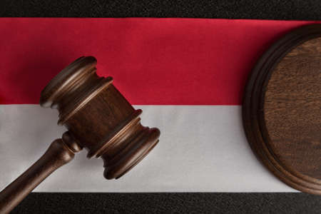 Lawyers wooden gavel against background of Polish flag. Close up. Law and justice. Imagens