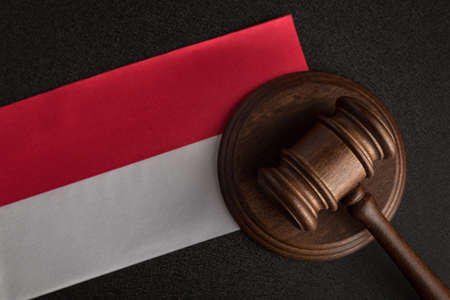 Lawyers wooden gavel and Polish flag. Close up. Law and justice.