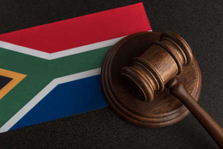 Judge gavel and flag South Africa. Law and justice. Constitutional law