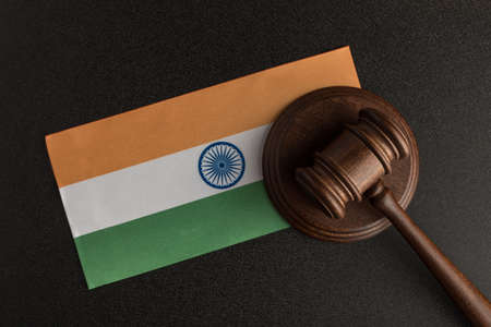 Judge Gavel and flag of India. Violation of human rights. Protection of rights population.