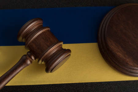 Judge Gavel and flag of Ukraine. Justice and law in Ukraine. Supreme court. Constitutional law.