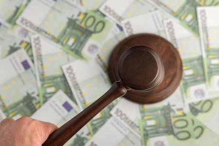 Judge hammer on Euro banknotes background. Judge gavel on the money. Corrupt court