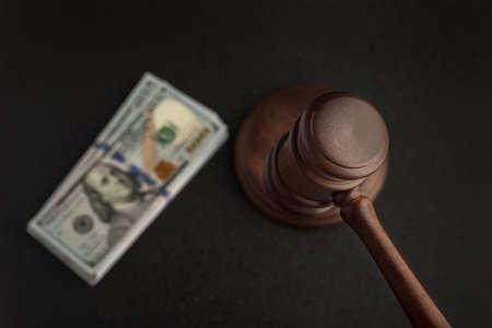 Wooden Judges gavel and bundles of dollars. Corrupt court. Bribery legislation in.