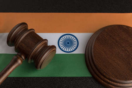 Judge Gavel and India flag. Violation of human rights. Law and justice.