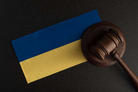 Judge Gavel and flag of Ukraine. Law and justice in Ukraine. Violation of rights and freedoms.