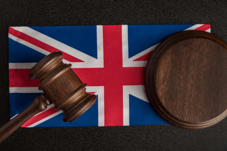 Judge gavel on the flag United Kingdom. Law and legality in UK. Violation of human rights.