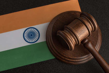 Judge Gavel and flag of India. Violation of human rights. Law and justice.
