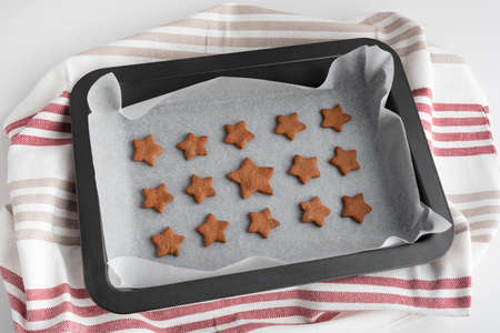 Star-shaped cookies on baking sheet. Freshly baked cookies.