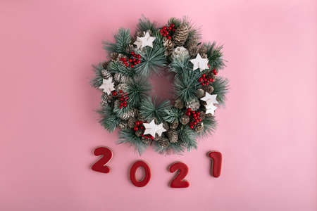 Christmas wreath and 2021 New year from gingerbread on pink background. Happy New Year 2021. Stok Fotoğraf