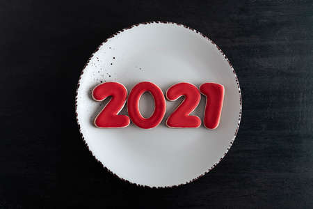 numbers 2021 on white plate top view. 2021 new year from gingerbread.