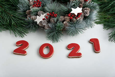 Inscription 2021 from gingerbread, Christmas wreath. White background. Happy New Year 2021 Stok Fotoğraf