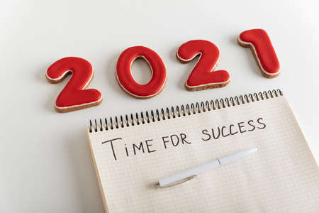 Figures 2021 and blank notebook on page with pen it is written: TIME FOR SUCCESS Stok Fotoğraf
