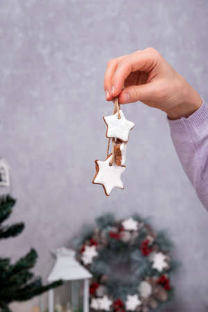 Star-shapes cookies for Christmas decoration. Christmas baked goods in female hand