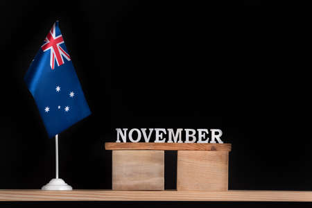Wooden calendar of November with Australian flag on black background. Holidays of Australia in November. Stok Fotoğraf