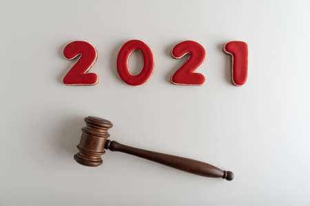 Red lettering 2021 and judges gavel or hammer on white background. Court case. Stok Fotoğraf