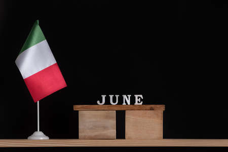 Wooden calendar of June with Italian flag on black background. Dates in Italy in June.