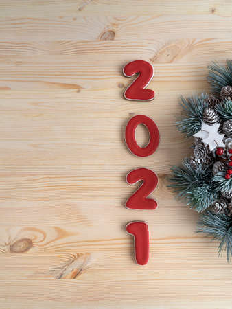 Inscription 2021 on wooden background. Christmas background. Christmas pattern. Vertical frame
