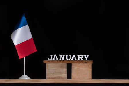 Wooden calendar of January with French flag on black background. Holidays of France in January. Stok Fotoğraf