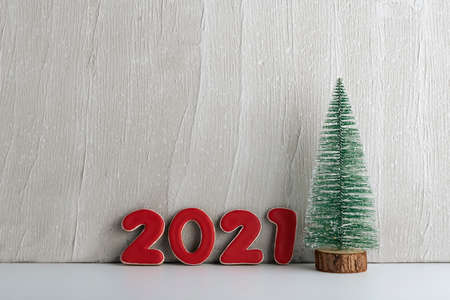 Artificial Christmas tree and red numbers 2021. New year concept. Copy space. Stok Fotoğraf