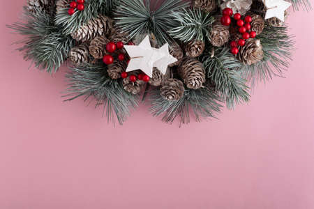 Christmas wreath on pink background. New Year pattern. Copy space. Stok Fotoğraf