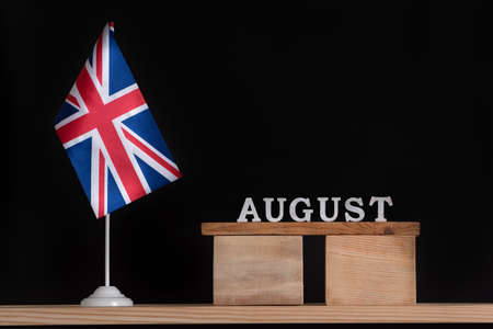 Wooden calendar of August with Great Britain flag on black background. Holidays of UK in August