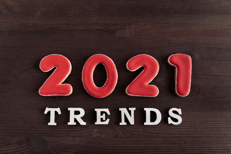 Inscription 2021 trends on wooden background. Popular destinations in 2021 Stok Fotoğraf