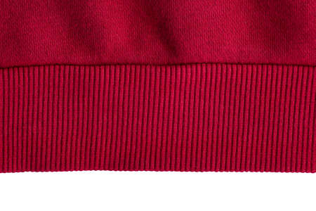 Knitted red elastic band on white background. Piece of clothing. Banque d'images - 167022528