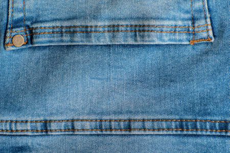 Jeans back pocket close up. Denim blue. Stitching on jeans. Rivets. Banco de Imagens
