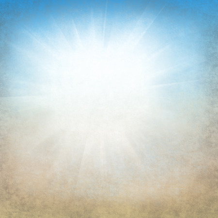 Summer background with a magnificent sun burst with lens flare. Hot with space for your message.