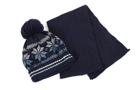 Cold winter clothing - hat or cap, scarf. photo