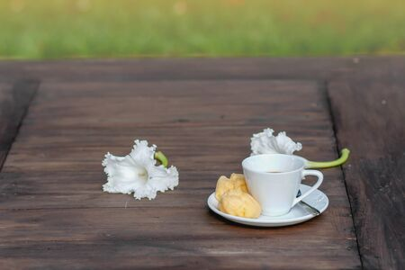 choux: Cup of coffee and Choux Cream on the wooden table