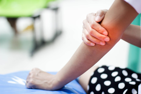 Woman suffering from an elbow injury Stock Photo
