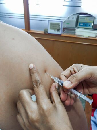 inject: nurse inject vaccine to patient Stock Photo