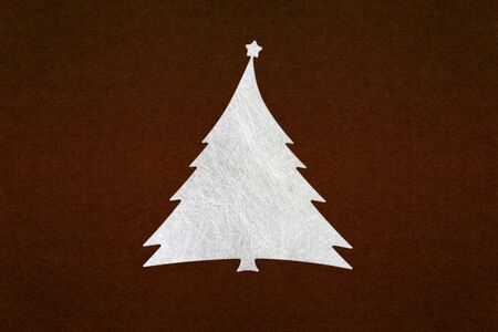 page background: silver fiber christmas tree on dark brown paper texture