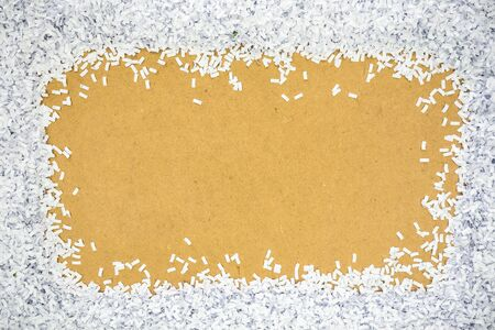 shred: fragment paper from perforation placed on cardboard Stock Photo