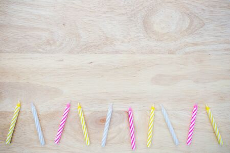 lit collection: birthday candle placed on wood Stock Photo