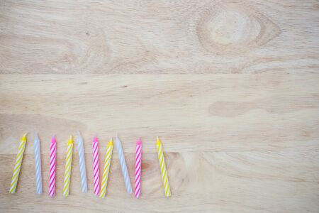 birthday candle placed on wood Stock Photo